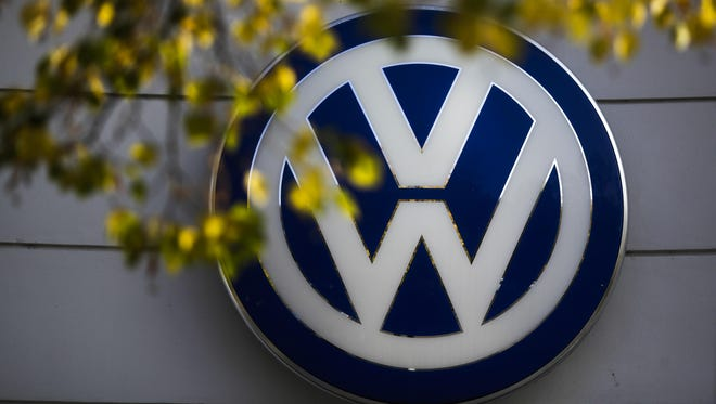 Tthe VW sign of Germany's car company Volkswagen is displayed at the building of a company's retailer in Berlin, Germany.