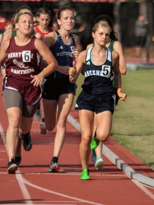 Ascension Episcopal's Kirsten Landry, right, shown here during last year's regional win in the 1600,  will extend her spectacular running career at LSU.