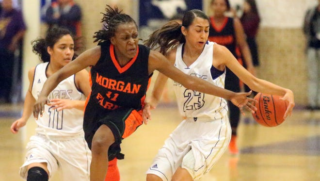 Gabrielle Cooper, 11, of Morgan Park High School in Chicago reaches to steal away the ball from Mia Lopez, 23 of Burges El Paso Thursday during the McDonalds Classic Basketball Tournament at Burges. Morgan Park prevailed 56-46.