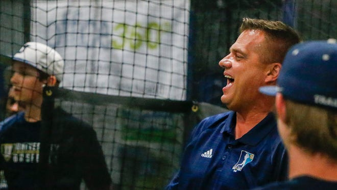 University's Head Coach Chris Estep makes a joke with his players at Roundtripper Sports Academy on Tuesday, June 12, 2018.