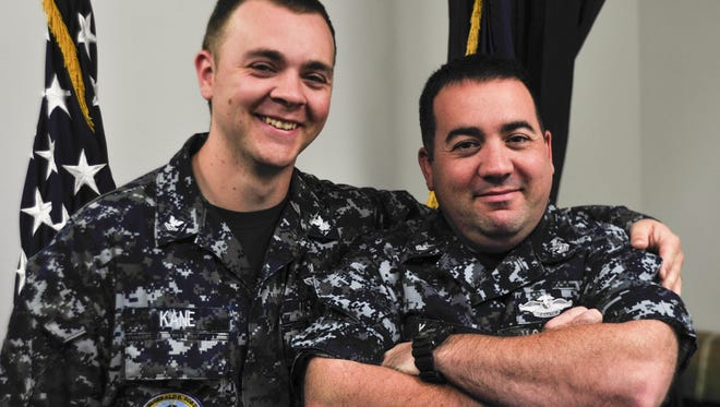 Hospital Corpsman 1st Class David Kane, right, and Culinary Specialist 2nd Class Steven Kane are serving together in the Navy.