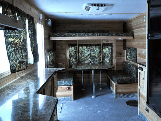 The Ice Castle RV-21 features an air conditioner, a
