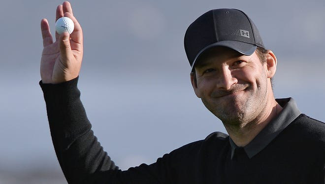 Tony Romo acknowledges the crowd on the 18th green at the 2018 AT&T Pebble Beach Pro-Am golf tournament at Pebble Beach Golf Links.