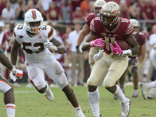 Florida State's George Campbell picks up yardage after a reception as Miami defender Zach McCloud closes in for the tackle in the fourth quarter of an NCAA college football game, Saturday, Oct. 7, 2017, in Tallahassee, Fla. Miami won 24-20. (AP Photo/Steve Cannon)