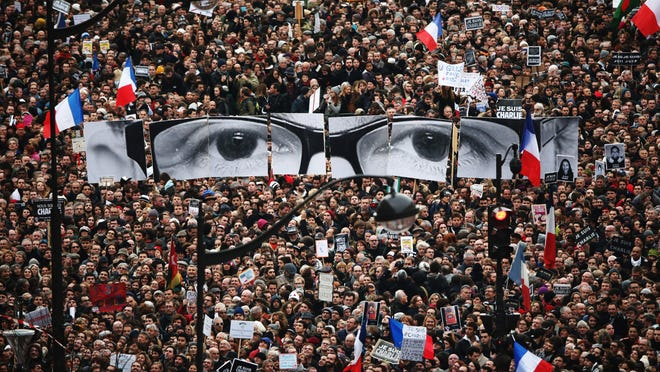 Demonstrators make their way along Boulevrd Voltaire in a unity rally in Paris following the recent terrorist attacks on January 11, 2015 in Paris, France.