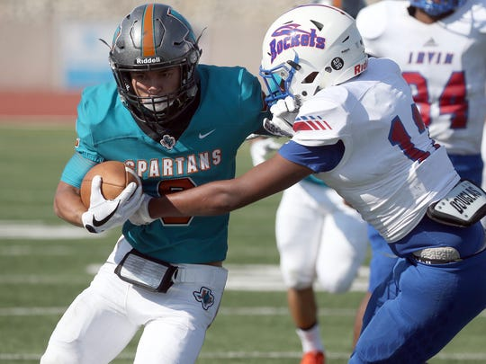 Caleb Gerber, 9, carries the ball for Pebble Hills against Irvin Thursday.