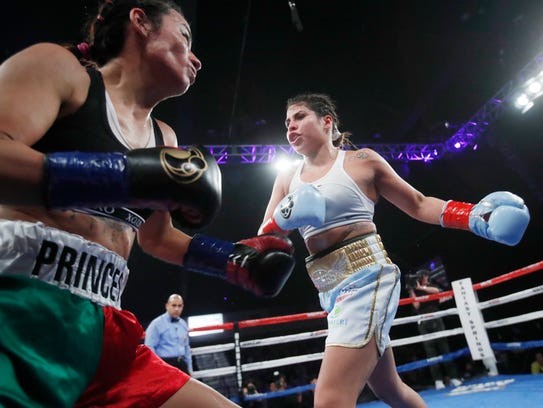 Marlen Esparza, at right, fights Karla Valenzuela during