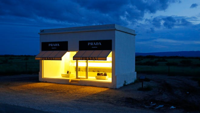 Dusk settles in over Prada Marfa, an art installation in Valentine, Texas. Marfa, a remote but trendy high desert town along the Texas border, is seeing a rising number of COVID-19 cases in another example the coronavirus now spreading into regions that were largely spared during past surges.