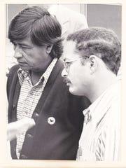 Activist César Chávez and spokesman Marc Grossman are shown at an event.