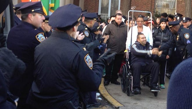 NYPD Officer Aliro Pellerano of Garnerville is released from the hospital Wednesday afternoon.