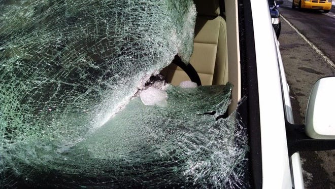 Franklin police say a woman was injured after ice flew off another vehicle and smashed her windshield.