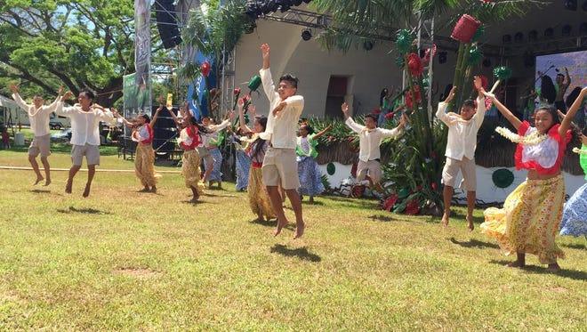 The Kulu Natibu Dance Squad from Agueda Middle School wows the crowd at the 28th Annual Guam Micronesia Island Fair June 12.