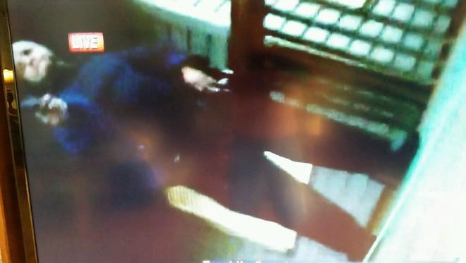 This is one of two still images of the male suspect that was taken from video that was recorded by a WDBJ camera moments after the shooting that killed two WDBJ employees.  The suspect is holding a weapon.