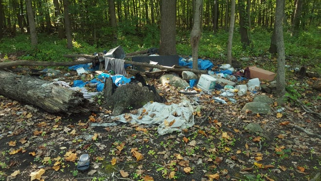 Trash along the Rockaway River in Dover prior to a previous cleanup by the Ridge and Valley chapter of Trout Unlimited.