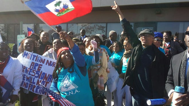 "Hundreds marched Monday through Spring Valley to protest a ""no haitians"" need apply ad that was published in a local Pennysaver."