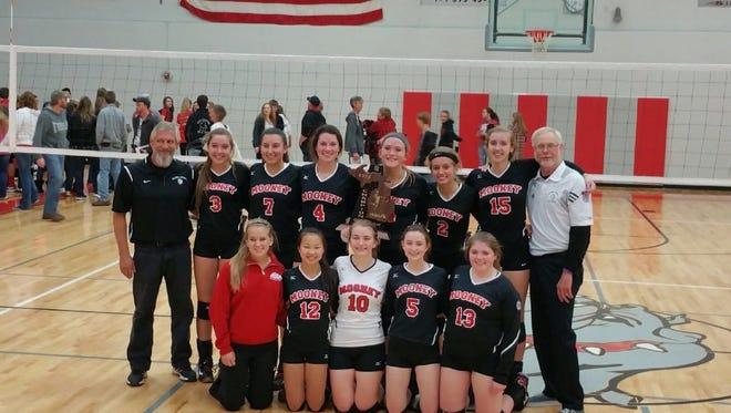 The Cardinal Mooney volleyball team won a regional title Thursday