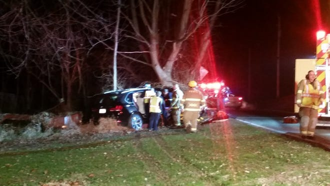 Emergency crews work at a crash scene in West Manheim Township on Dec. 9.