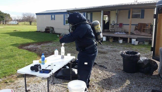 Emergency personnel process evidence of an alleged meth lab following the search of a home near Plymouth last month.