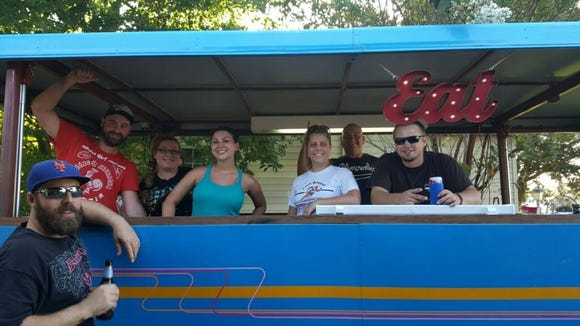Friendships formed during neighborhood cookouts led to the development of The Cajun Table, which is part restaurant, part food truck and part catering service. This photo, taken last summer, includes members of The Cajun Table crew and their friends, from left: Logan Gautreaux, Sean Suire, Lauren Liner, Leigh Trumps, Caroline LaFleur, Dustin Trumps and Josh Trahan.