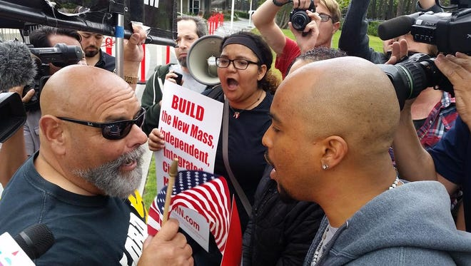 Opposing groups shout outside of the Donald Trump rally in Anaheim on Wednesday, May 25, 2016.