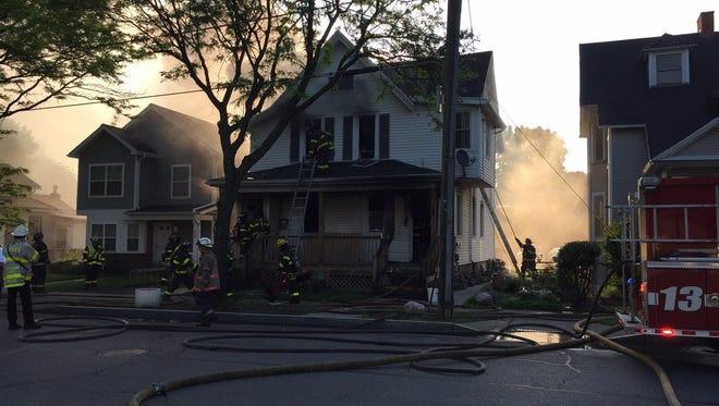 Rochester firefighters battle a blaze at 74-76 Jefferson Ave. Monday morning.