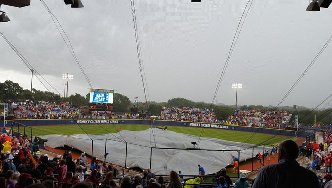 Alabama and Oklahoma are in the midst of a rain delay at the Women's College World Series in Oklahoma City.
