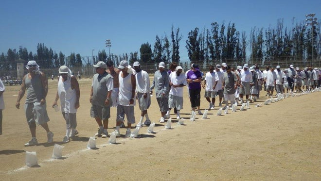 CTF inmates participate in the survivor walk at the prison's first Relay for Life event on Saturday.