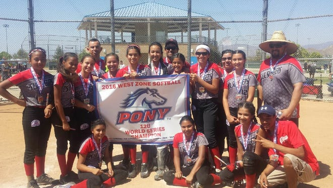 The 12U Palm Springs Lil Sluggers proudly display their newly won PONY World Series banner. The team has won three World Series.
