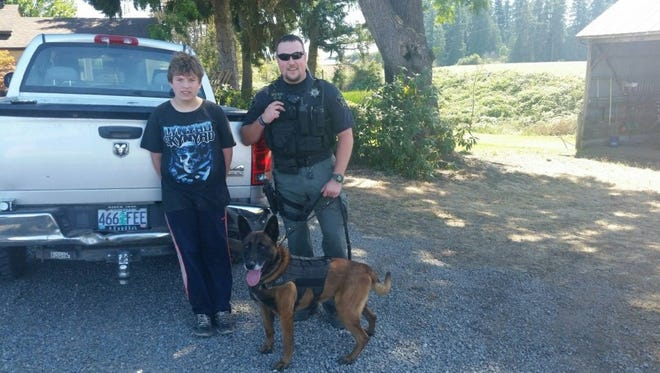 Austin Davis, left, with Deputy Jason Bernards and his K-9 partner Rolo.