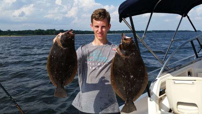 Jerry Yaros of Metuchen sent in this photo of his grandson Jonathon holding two very nice fluke.