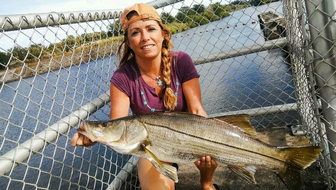 Regina Danielson of Port St. Lucie caught and released this oversized snook while fishing Tuesday at the St. Lucie Locks with a Yo-Zuri crystal minnow.