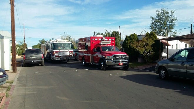 Police and fire vehicles line the streets near a mobile home park where a man barricaded himself inside a residence.