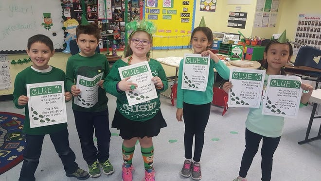 Students in Sarah Moore's first-grade class at The Ellison School celebrated St. Patrick's Day by trying to catch the leprechaun who came into their room and made a mess! The students used clues left by the leprechaun to hunt around the school. Unfortunately, they couldn't find him but he did leave them treats!