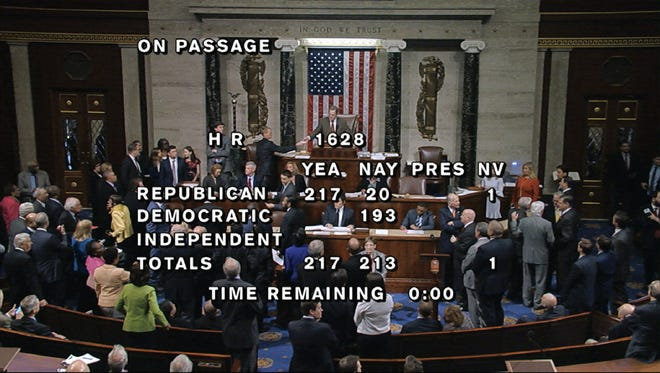 In this image from House Television, the final total on the vote on the Republicans' health care bill is displayed at the Capitol on Thursday.