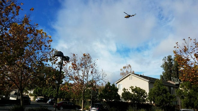 A Ventura County Sheriff's helicopter searches a Newbury Park neighborhood Friday morning after a report of an armed robbery.