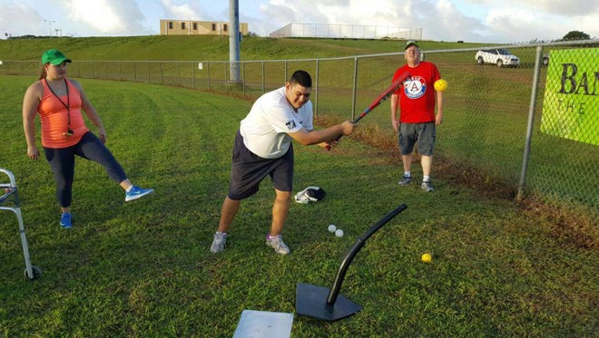 Terry Palomo takes a swing during practice.