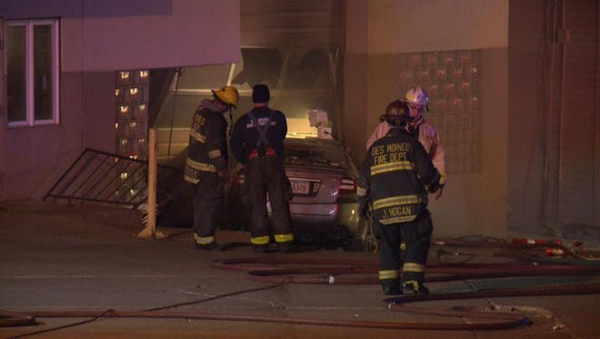 Two people were injured Monday when a car crashed into Hilltop Tire Service, 2914 Hubbell Ave. The car caught fire.