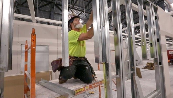Rick Teklics, of Common Links Construction of Brookfield, works Tuesday at the future Ikea store on 29 acres along W. Drexel Ave. near I-94 in Oak Creek.