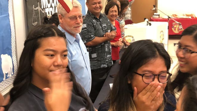 Members of the Okkodo High School mock trial team erupted in cheers and tears upon hearing news that they'll be the first to fly to national competition with miles granted through a new government program.