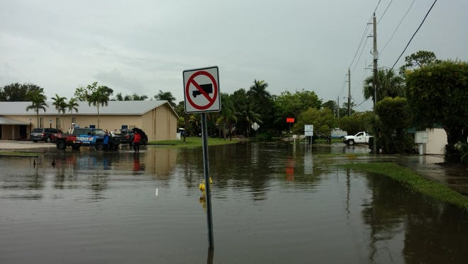 Intersection at Sunset Trail and Mapp Road is closed in Martin County due to flooding.