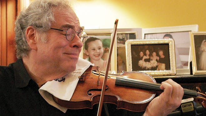 """Itzhak Perlman rehearses a classical piece at his Manhattan apartment in the documentary """"Itzhak."""""""