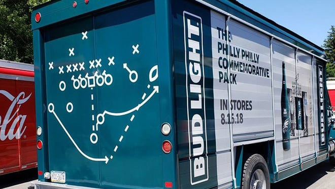 "A new Bud Light truck commemorates the Eagles' Super Bowl win, and is set to deliver beer bearing the team's logo on Aug. 16 — when the Birds face the Patriots in a preseason game. Shown here is the ""Philly Special"" — a play that set up Nick Foles' fourth-and-goal touchdown that propelled the Eagles to victory."