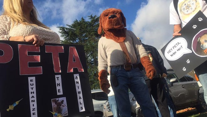 Protesters gearing up to march against PETA after members took and killed family dog.