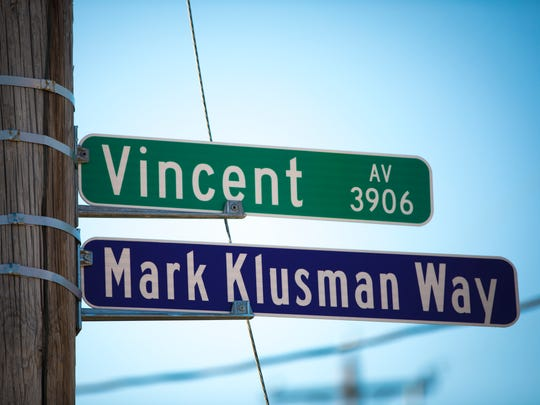 Thursday, March 15, 2018: A crowd of students gathered on Vincent and Regina Avenues in West Price Hill in honor of Elder High School teacher Mark Klusman on Thursday.ÊThe street was renamed to honor the man who was remembered as a mentor to many. Klusman died of his injuries after being struck while he was volunteering forÊa community clean-up event in December. The Enquirer/Carrie Cochran
