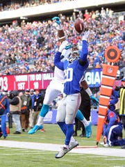 Dec 20, 2015; East Rutherford, NJ, USA; New York Giants corner back Prince Amukamara (20) defends a pass intended for Carolina Panthers wide receiver Devin Funchess (17) during the third quarter at MetLife Stadium. The Panthers defeated the Giants 38-35. Mandatory Credit: Brad Penner-USA TODAY Sports