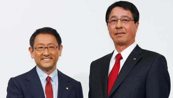 Toyota Motor Corp. President Akio Toyoda, left, and Mazda Motor Corp. President Masamichi Kogai pose for photographers in Tokyo on May 13 2015.