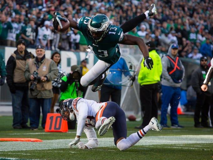 Eagles' Nelson Agholor flips over Chicago's Kyle Fuller