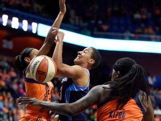 Atlanta Dream's Layshia Clarendon, center, is fouled by Connecticut Sun's Lynetta Kizer, right, as Sun's Jasmine Thomas, left, defends during the first half of a WNBA basketball game Saturday, May 13, 2017, in Uncasville, Conn. The Dream won 81-74. (Sean D. Elliot/The Day via AP)