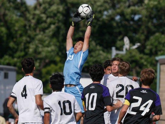 West Des Moines Valley sophomore goalie Kevin Qi stops