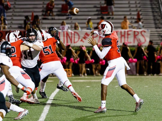 Petal quarterback Jordan Wilson passes to a receiver down the field Friday during the Panthers' game against Brandon.